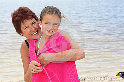 Woman and kid by the seaside