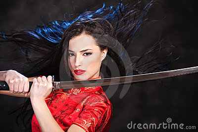 Woman in kimono with katana sword