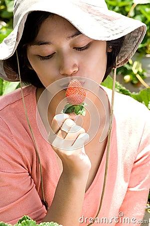 Woman kiss strawberry