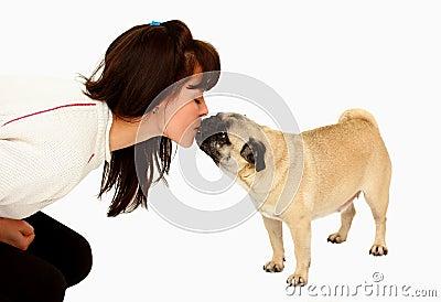 Woman kissing a dog mops