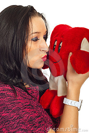 Woman kissing a heart toy