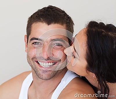 Woman kissing her Boyfriend