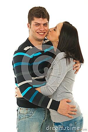 Woman kissing her boyfriend cheek