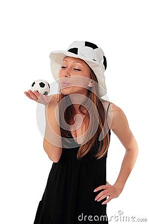 Woman kissing a little football