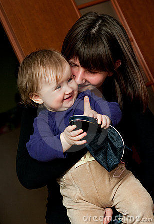 Woman kissing young sister