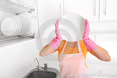 Woman in kitchen with plate
