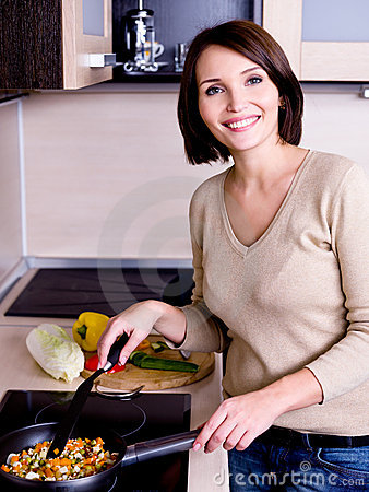 Woman is on the kitchen prepares to eat