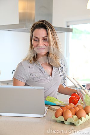 Woman in kitchen preparing lunch