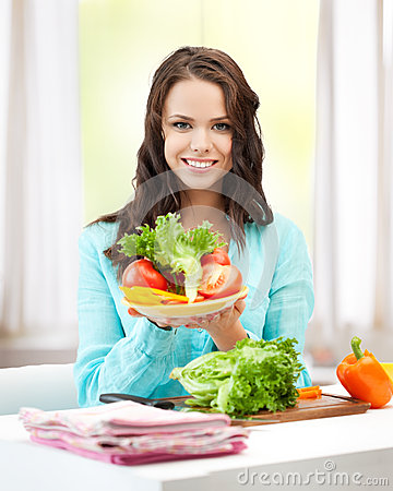 Woman in the kitchen with vegetables