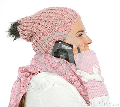 Woman in knit winter clothing speaking mobile