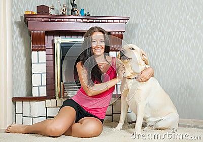 Woman with  Labrador retriever