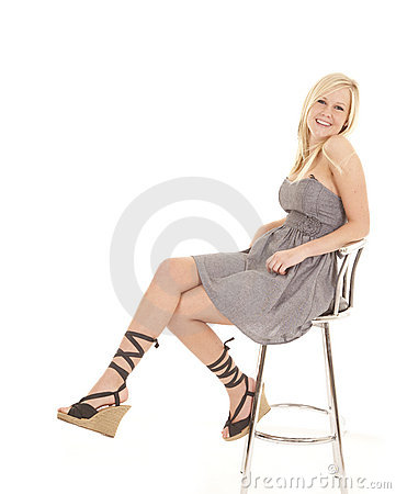 Woman laced shoes sit stool