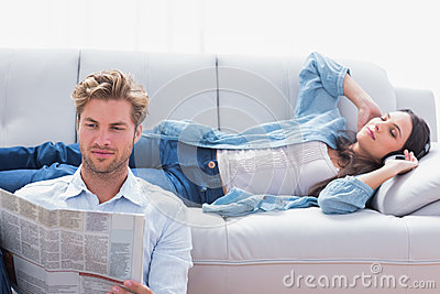 Woman laid on a couch listening to music