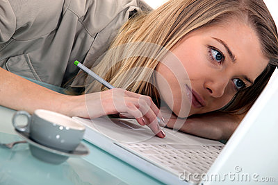 Woman laid on her laptop
