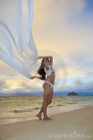 Woman on lanikai beach at sunrise