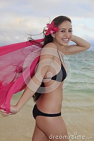 Woman on lanikai beach at sunrise