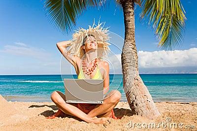 Woman laptop beach