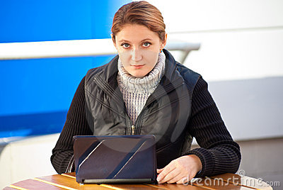 Woman with laptop in the cafe