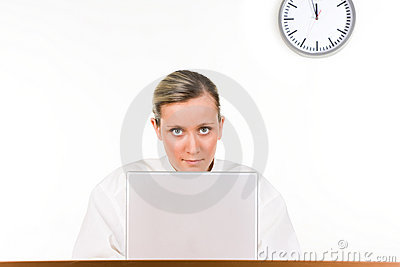 Woman with laptop and clock