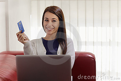 Woman with laptop and credit card shopping