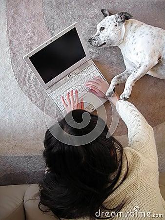 Woman laptop dog
