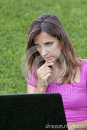 Woman laptop grass
