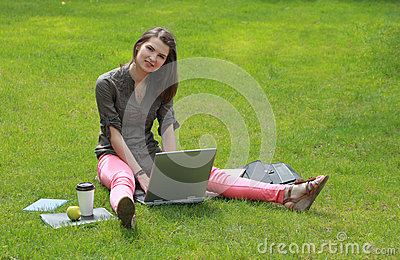 Woman with a Laptop in Grass