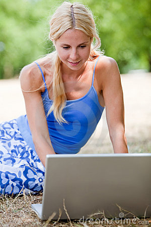 Woman with a laptop outdoors