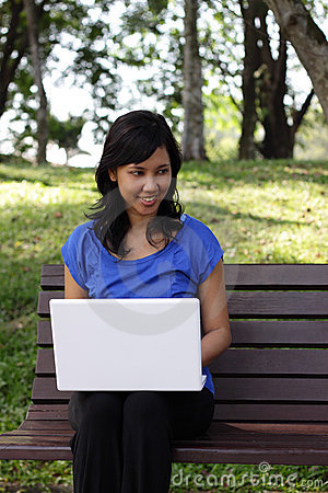 Woman with laptop outdoors