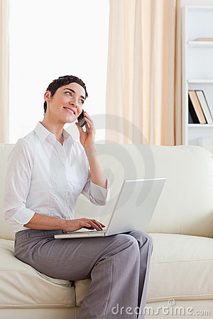 Woman with a laptop and a phone
