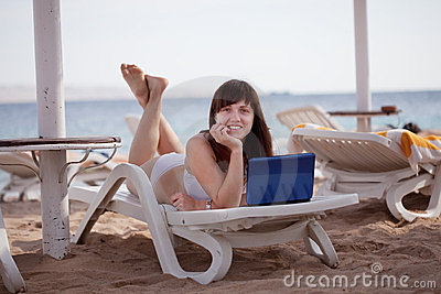 Woman  with laptop at resort