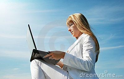 Woman with laptop sitting