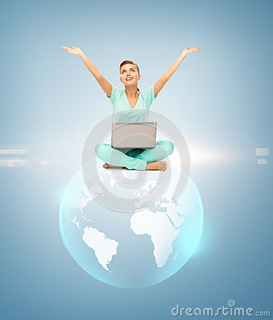 Woman with laptop and sphere globe
