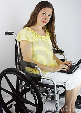 Woman With Laptop In Wheelchair