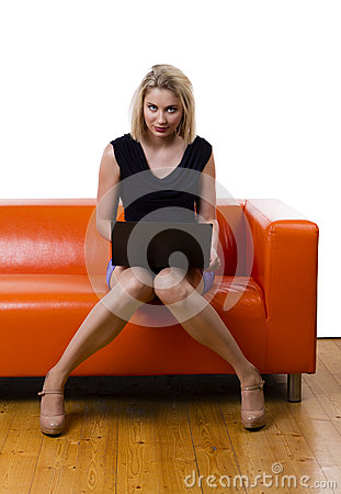 woman laptop young beautiful sexy sitting couch isolated white 51939480