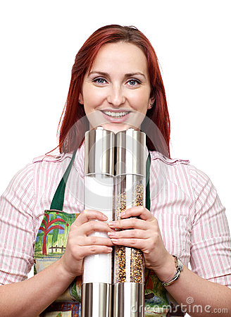 Woman with large salt and pepper mills