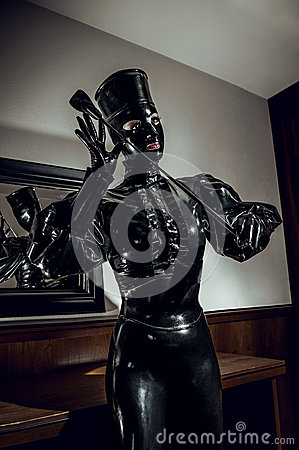 Woman in latex fetsih black costume