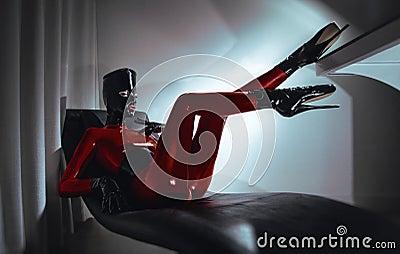 Woman in latex fetsih red costume