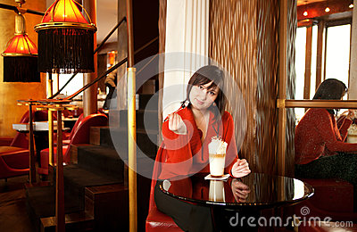 Woman with latte in cafe