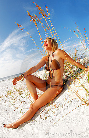 Woman laughing on beach