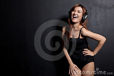 Woman laughing with headphones