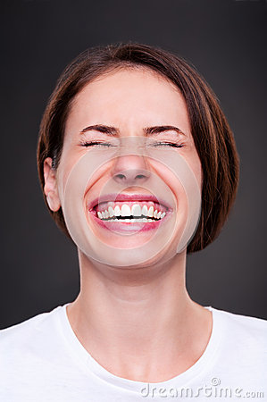 Woman is laughing loudly