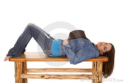 Woman lay on bench hat sleep