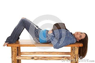 Woman lay on bench hat sleep