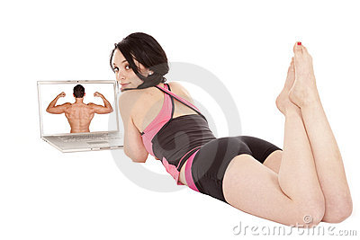 Woman laying by computer looking back