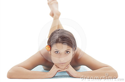 Woman laying on the floor at spa session