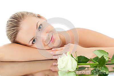 Woman laying on mirror