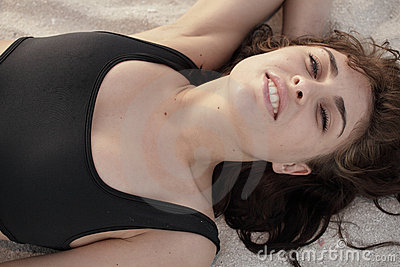 Woman laying on the sand