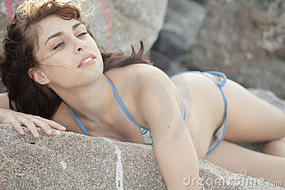 Woman laying on teh rocks