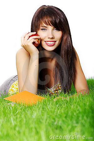 Woman lays on grass